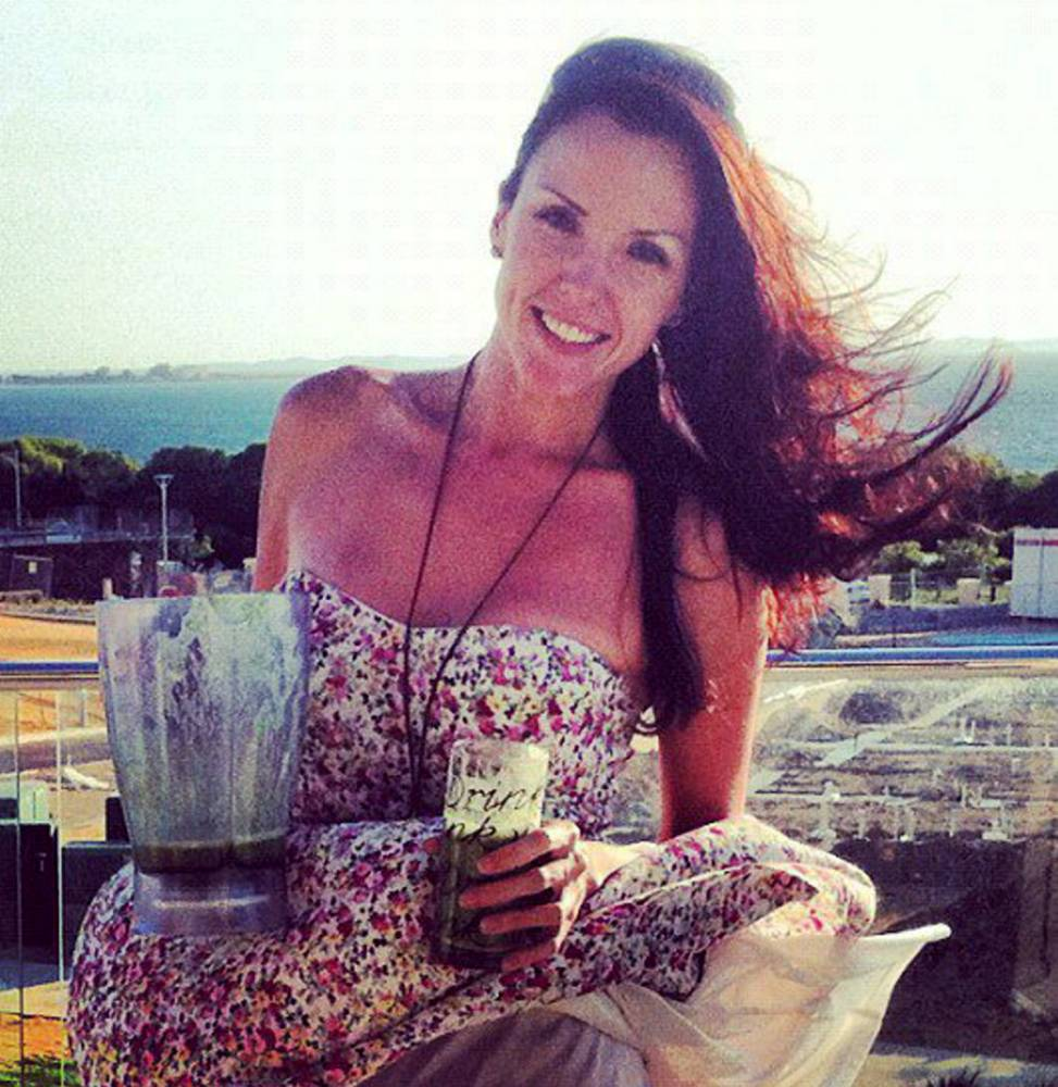 """Candice-Marie Fox with one of the fruit smoothies she drank to help beat her cancer. See SWNS story SWCANCER: A woman who was given just five years to live after being diagnosed with an aggressive cancer has CURED herself - thanks to PINEAPPLES. Candice-Marie Fox, 31, found out she had thyroid cancer and reluctantly went under the knife to remove more than 20 lumps three years ago. But when the disease spread and doctors said she had a maximum of five years to live, determined Candice rejected life-lengthening chemotherapy which had """"killed"""" friends. She gave her life an overhaul in bid to banish the disease, and munched on up to THREE pineapples a day - as well as dozens of grapefruits, lemons, apples, kiwis and bananas. Pretty Candice, from Houghton Regis, Hertfordshire, said: """"I changed my whole outlook on life."""