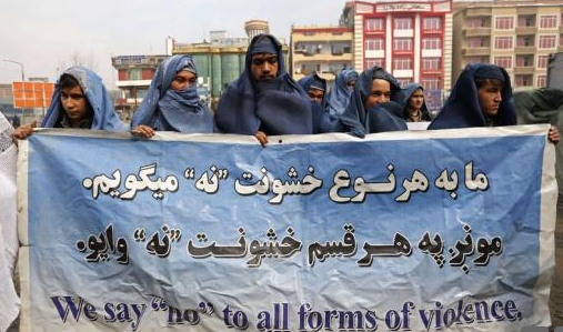 These men in Kabul took a defiant stand against the oppression of women (Picture: Reuters)
