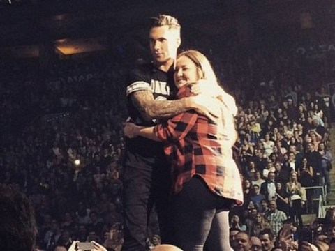 Fan hit on head by microphone at Maroon 5 concert says 'It was a dream come true'