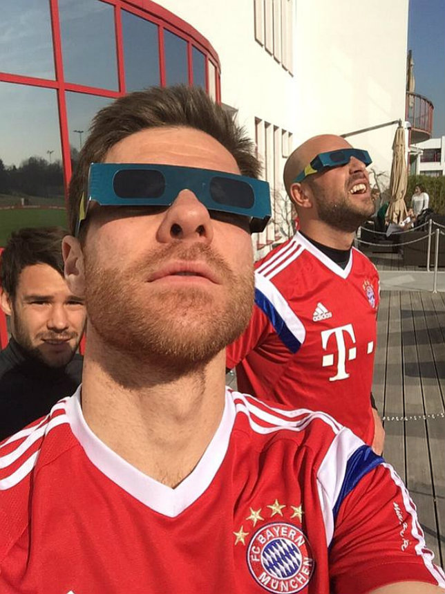 Bayern Munich stars Xabi Alonso and Pepe Reina rock solar eclipse shades
