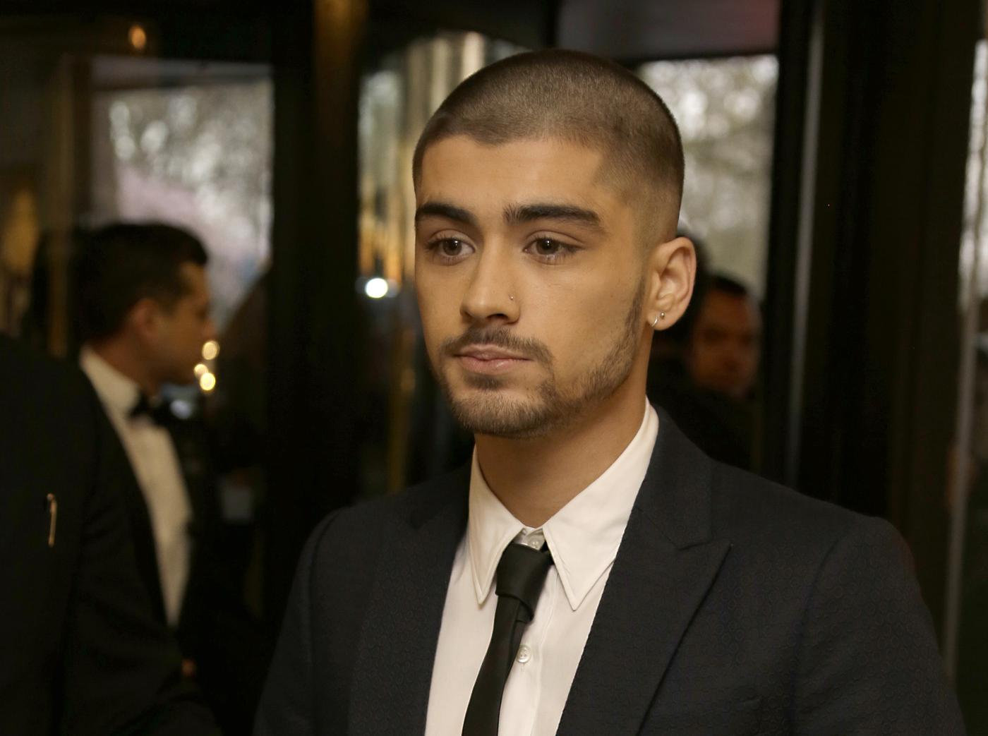 Zayn Malik poses for photographers upon arrival at The Asian Awards in central London, Friday, 17 April, 2015. (Photo by Joel Ryan/Invision/AP) Joel Ryan/Invision/AP
