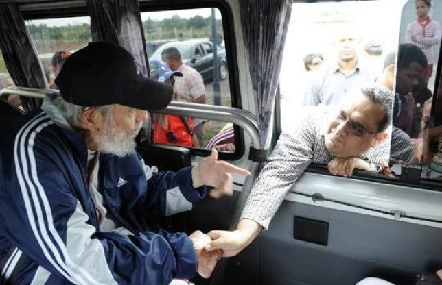 Fidel Castro, greets a person during a meeting with a group of Venezuelan citizens in the city of Havana  Fidel Castro meets with a group of Venezuelan citizens, Havana, Cuba - 30 Mar 2015  According to local press, Fidel Castro met in Havana (Picture: Rex)