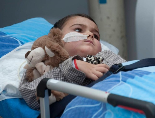 Five-year-old Ashya King leaves the Proton Therapy Centre in Prague, Czech Republic, with his parents after preparations for the treatment of his brain tumour.