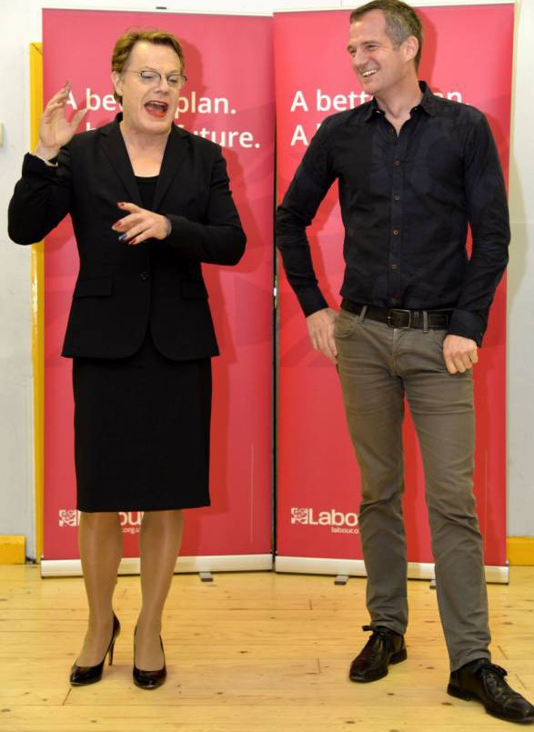 """Comic Eddie Izzard was dressed to impress as he went vote-hunting with a Labour politician - whilst wearing make-up and a skirt-suit.  The actor and comedian joined a Labour candidate at the event wearing an all blue outfit complete with the Union Jack painted on his nails. He said that his cross-dressing might not get approval from senior MPs but that the UK was a """"much more progressive place"""" than it was 30 years ago.  The 53-year-old, who plans on running for London mayor in five years time, met with the public to answer questions in Portslade, in Brighton and Hove, East Sussex.  SEE OUR COPY FOR DETAILS. Pictured: Comedian and Labour Party activist Eddie Izzard (left) joined prospective MP Peter Kyle (right) for a Q&A session in Portslade. © Brighton Argus/Solent News & Photo Agency UK +44 (0) 2380 458800"""