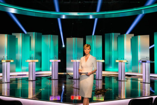 SALFORD, ENGLAND - APRIL 1: (EMBARGO: NOT FOR PUBLICATION BEFORE 22.00hrs.WEDNESDAY.1st APRIL, 2015. EDITORIAL USE ONLY. NO MERCHANDISING. NO ARCHIVE AFTER MAY 14, 2015)  In this handout provided by ITV,  Julie Etchingham prepares in front of the seven lecterns set up for (L-R): Green Party leader Natalie Bennett,  Liberal Demorcrats leader Nick Clegg, Ukip's leader Nigel Farage, Labour leader Ed Miliband, Plaid Cymru leader Leanne Wood, Scottish National Party's leader Nicola Sturgeon and Conservative leader David Cameron ahead of the ITV Leaders' Debate 2015 which will take place tomorrow evening in the studios of MediaCityUK on April 1, 2015 in Salford, England. (Photo by ITV via Getty Images)