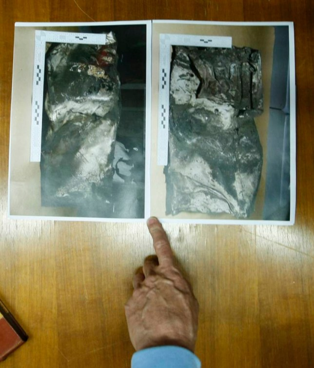 Pictures showing the second black box from the Germanwings plane that crashed in the French Alps last week, are displayed for the media during a press conference in Marseille, southern France, Thursday, April 2, 2015. Marseille prosecutor Brice Robin announced that a gendarme found the second black box flight recorder of Germanwings Flight 9525, blackened and buried in the soil of the Alps, and investigators hope to be able to analyse its data for more clues to what happened. (AP Photo/Claude Paris)