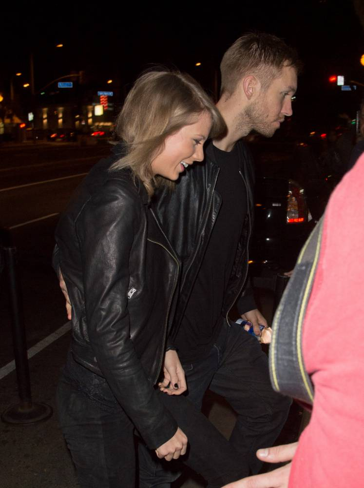 It's an official Love Story! Taylor Swift and Calvin Harris subtly confirm romance by leaving gig hand in hand