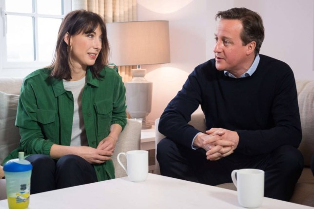 British Prime Minister and leader of the Conservative Party, David Cameron (R) and his wife Samantha (L) sit in a showhome during a general election campaign visit to a housing development with a family in Chorley, northwest England, on April 3, 2015. British Prime Minister David Cameron and his austerity policies came under attack on April 2 from six other party leaders in the only full debate before next month's general election. AFP PHOTO / POOL / LEON NEALLEON NEAL/AFP/Getty Images