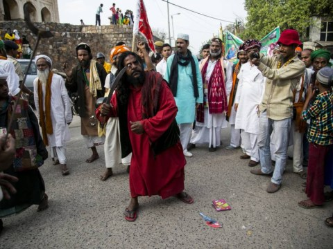 Muslim faqir puts knife into his eye during religious procession