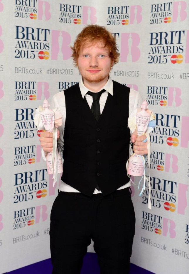 Singer Ed Sheeran with his awards for Best British Male Solo Artist and British Album of the Year in the press room at the 2015 Brit Awards at the O2 Arena, London, England.  PRESS ASSOCIATION Photo. Picture date: Wednesday February 25, 2015. See PA story SHOWBIZ Brits. Photo credit should read: Dominic Lipinski/PA Wire