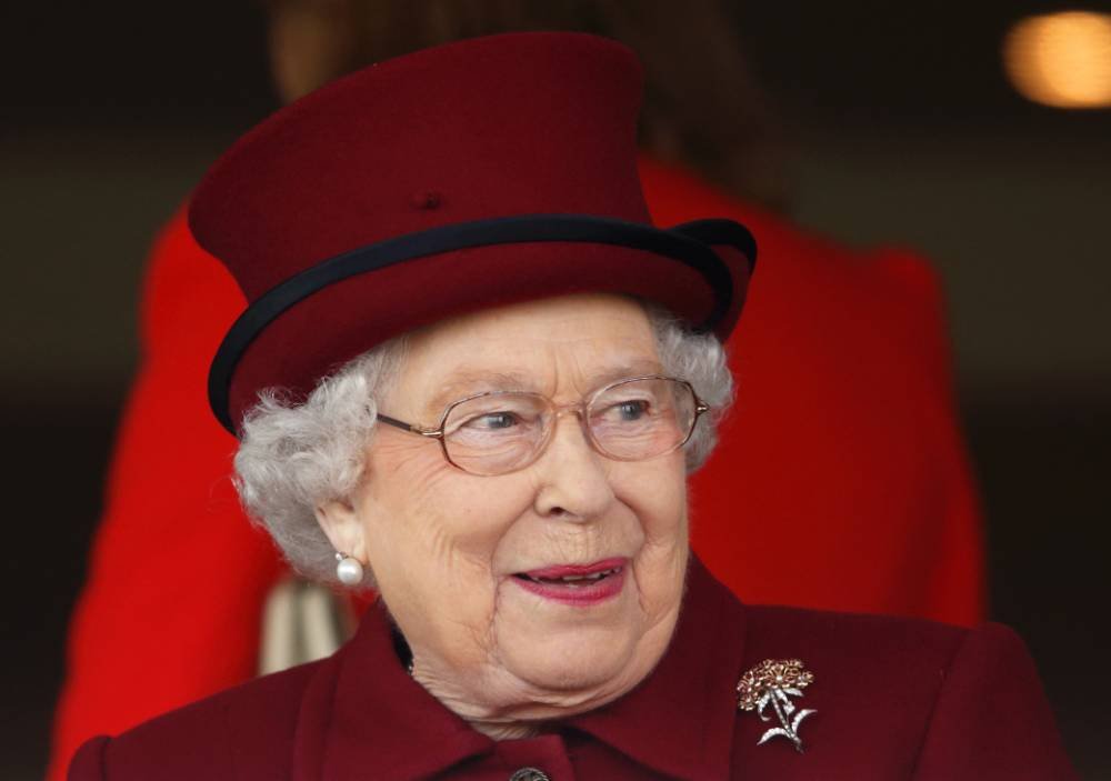 NEWBURY, UNITED KINGDOM - APRIL 11: (EMBARGOED FOR PUBLICATION IN UK NEWSPAPERS UNTIL 48 HOURS AFTER CREATE DATE AND TIME) Queen Elizabeth II watches her horse Fiery Sunset run in the Whitley Stud Maiden Fillies' Stakes as she attends the Dubai Duty Free Spring Trials Meeting at Newbury Racecourse on April 11, 2014 in Newbury, England. (Photo by Max Mumby/Indigo/Getty Images)