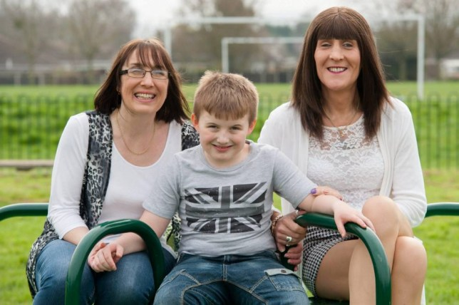 (Left - right) Jo Wallace, 44, William Wallace, 9, and Roxanna Louisa Wallace, 50, pose for a portrait near their home. Gloucester, England. See SWNS story SWSWAP: A miserable father can finally have a joyful relationship with his son after beating depression ñ by becoming the boyís second MOTHER. Up until two years ago, 50-year-old Roxy Wallace was a burly bodyguard named ëBobí who suffered from such severe depression he never played with his son William. But one day cross-dressing Bob finally opened up to wife of 20 years Jo, and said he wanted to live as a woman called Roxy.  Ever since, Roxy, now a stay-at-home mum, has had a better relationship with nine-year-old William, who is on the autistic spectrum, because living as a woman has helped her beat her battle with depression.