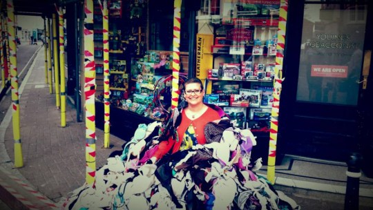 Heather Walters with her giant pile of bras. A mother has inspired a breast-cancer campaign that saw 1600 bras and pants slung onto scaffolding has finished her treatment ñ on the day they all came down. See swns story SWBRAS. Inspirational mother-of-two Heather Walters had her final radiotherapy session and then celebrated by counting the mounds of underwear that had created such an eye-catching display. Heather, 34, launched her ëcheck yourself, donít wreck yourselfí campaign in September, asking the public to ëflingí their bras and underpants on the Youings building in Barnstaple, Devon, for charity. The underwear-clad scaffolding ñ that even featured a ëmankinií ñ has been dismantled with all the donations now set to be washed and sent to help support women in Africa. Beauty therapist Heather, of Barnstaple, said she was stunned at how successful the stunt had become and her campaign has raised more than £11,000 for CoppaFeel. She is now working on an auction of celebrityís bras and pants in the autumn - with Kelly Brook, Alan Titchmarsh, Michael Owen and John Bishop among the big names to already send in their items. She said: ìI had my last radiotherapy treatment and on the same day the bras all came down. It felt very emotional.