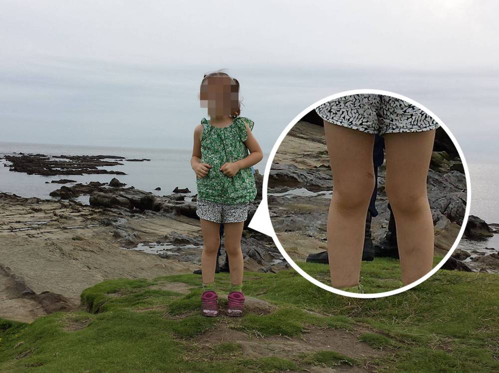 Are these the boots of a dead SAMURAI? Ghostly image of a pair of feet behind a little girl standing on a Japanese shore 'near warrior tombs' sparks internet frenzy