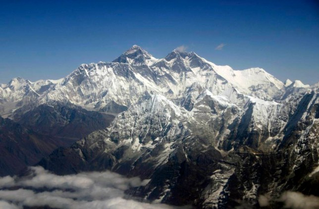 FILE - This Oct. 21, 2005 file photo shows Mount Everest from an aerial view taken over Nepal. Senior mountaineering guide, Ang Tshering, said an avalanche swept the face of Mt. Everest after the massive earthquake, Saturday April 25, 2015 while government officials say at least 30 people have been injured on the mountain.  (AP Photo/Jody Kurash, File)