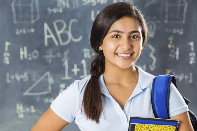 Portrait of Indian high school student in classroom