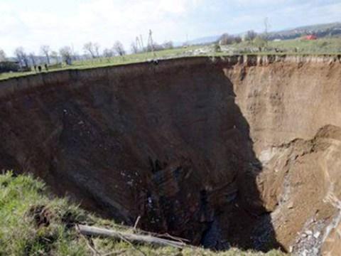 100-metre sinkhole 'swallows seven houses' in Ukraine