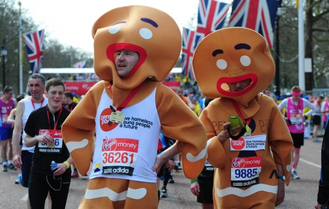 Two Ginger bread men finish the London Marathon Walking down from the finish to baggage reclaim. London, UK, 21/04/2013, Picture by Georgie Gillard  . REXMAILPIX.