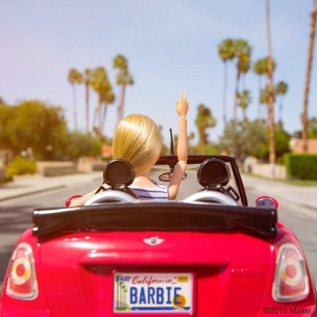 Barbie in her Barbie mini car