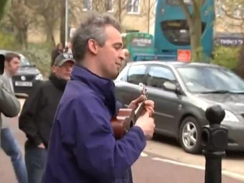 Ukulele-playing busker tells David Cameron to 'F**k off back to Eton'