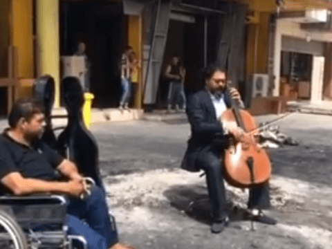 Cellist defiantly plays in a Baghdad street blackened by a recent car bomb