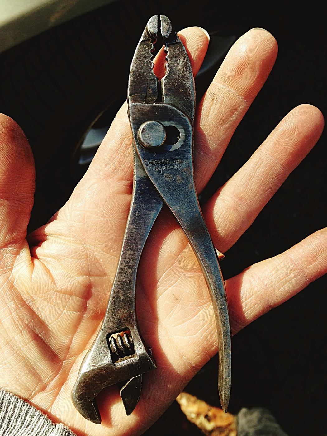 Cropped Image Of Man Holding Pliers