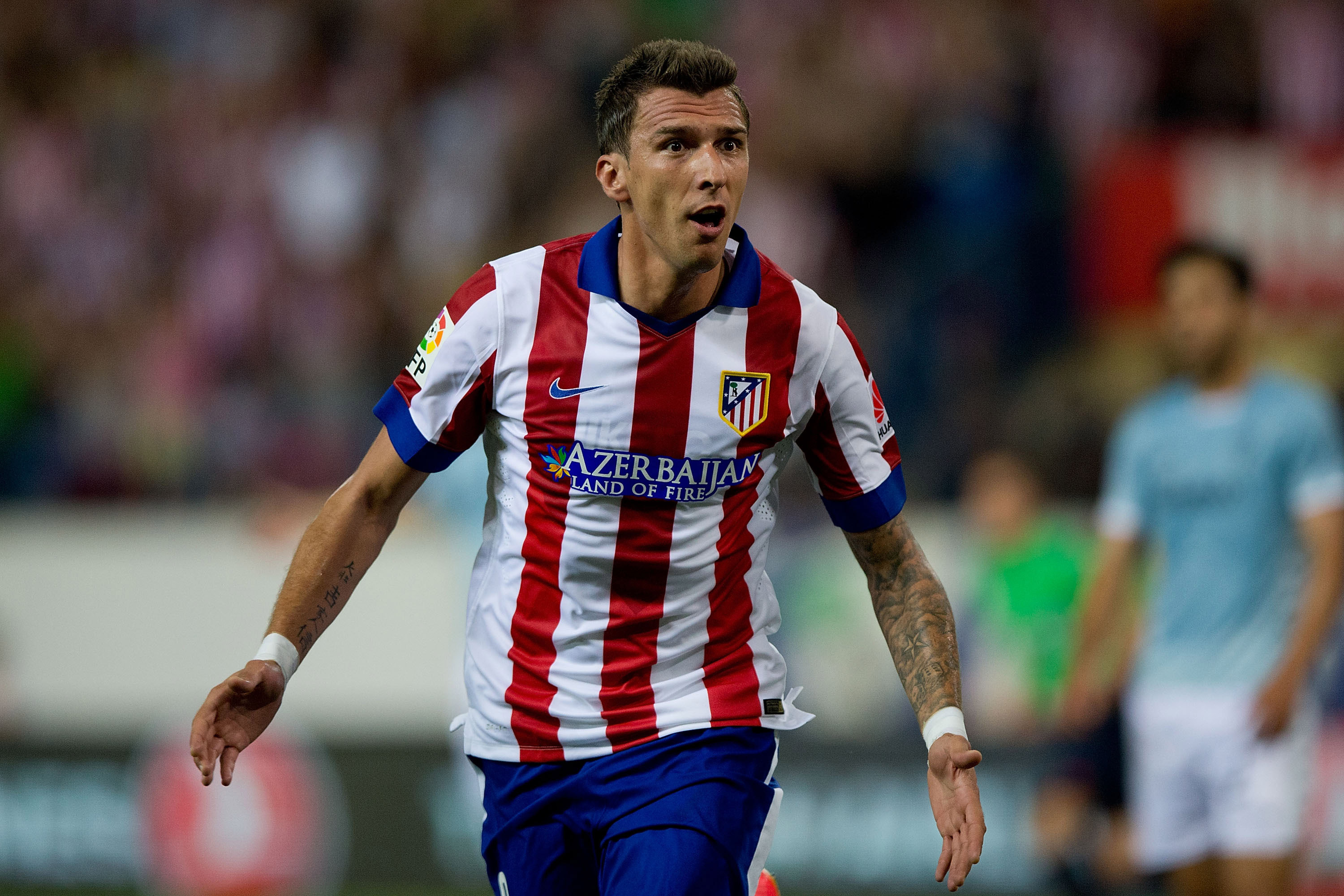 MADRID, SPAIN - AUGUST 30:  Mario Mandzukic of Atletico de Madrid celebrates scoring their second goal during the La Liga match between Club Atletico de Madrid and SD Eibar at Vicente Calderon Stadium on August 30, 2014 in Madrid, Spain.  (Photo by Gonzalo Arroyo Moreno/Getty Images)