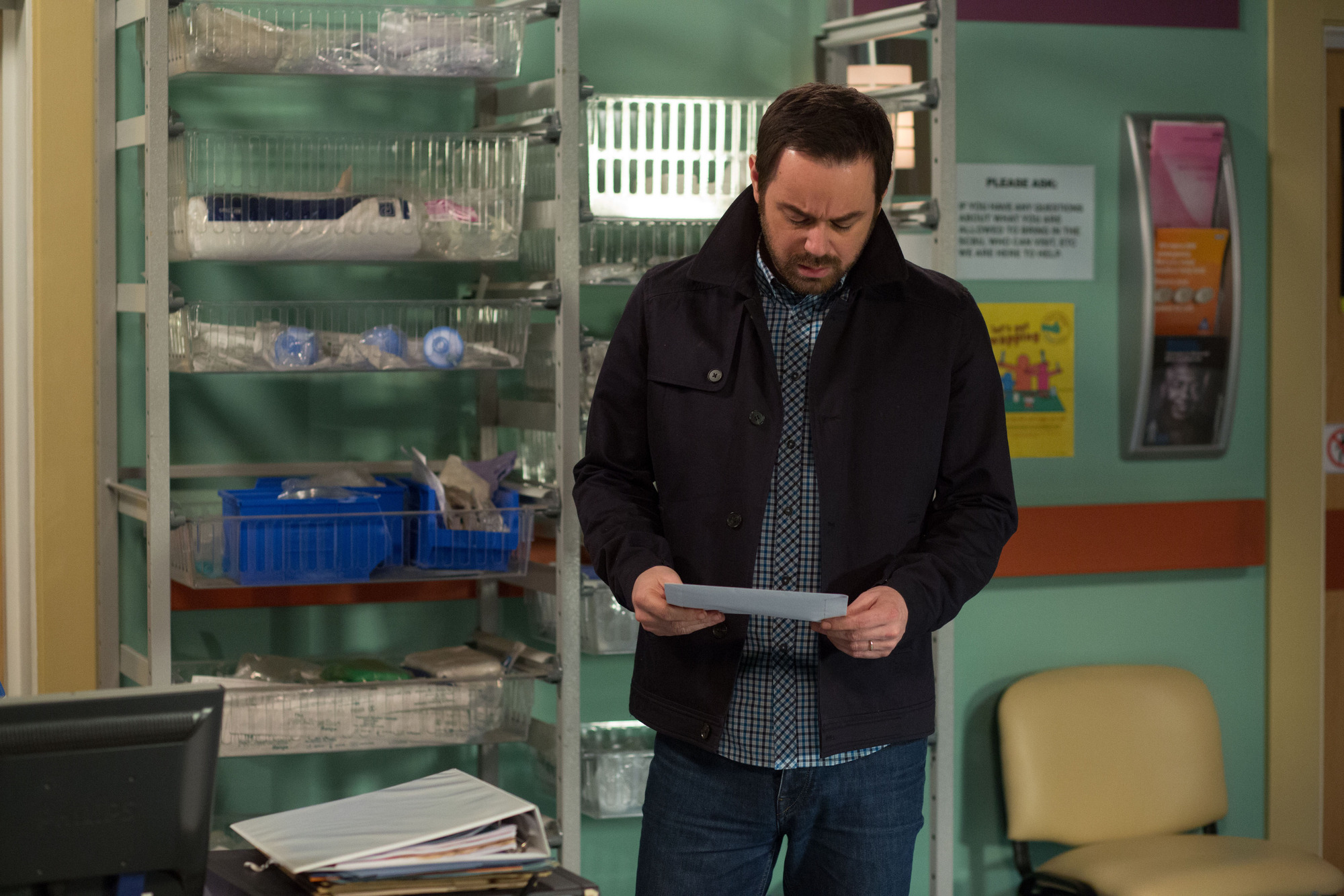 WARNING: Embargoed for publication until 05/05/2015 - Programme Name: EastEnders - TX: 15/05/2015 - Episode: 5068 (No. n/a) - Picture Shows: Mick reads the results of the baby Mick Carter (DANNY DYER) - (C) BBC - Photographer: jack Barnes