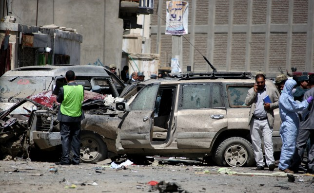 Afghan security forces gather around a destroyed vehicle at the site of a suicide car bombing  Bomb blast in Kabul, Afghanistan Picture: Rex) Shutterstock (4775488h)  - 17 May 2015  Four people were killed and several others wounded when a suicide car bomb exploded near the airport of the Afghan capital Kabul on Sunday, sources and witnesses said.