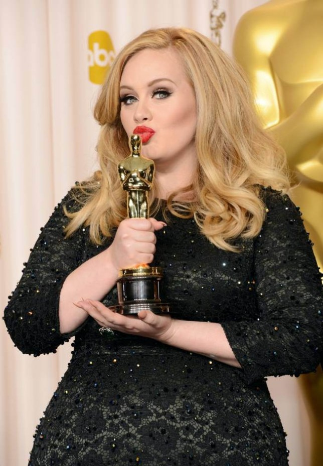 "Singer Adele, winner of the Best Original Song award for ""Skyfall,"" poses in the press room during the Oscars held at Loews Hollywood Hotel on February 24, 2013 in Hollywood, California.  (Photo by Jason Merritt/Getty Images)"