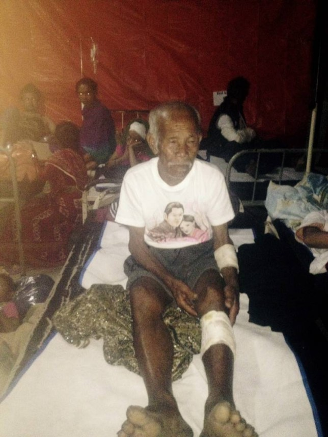 "Funchu Tamang, 101, sits on a bed in a hospital in Nuwakot district on May 3, 2015 around 80 kilometres (50 miles) northwest of Kathmandu where he was taken after being rescued from his collapsed home a day earlier.  Rescuers have pulled a 101-year-old man alive from his ruined home a week after Nepal's earthquake claimed at least 7,200 lives, as the government warned Sunday the death toll will climb ""much higher"".      AFP PHOTOSTR/AFP/Getty Images"
