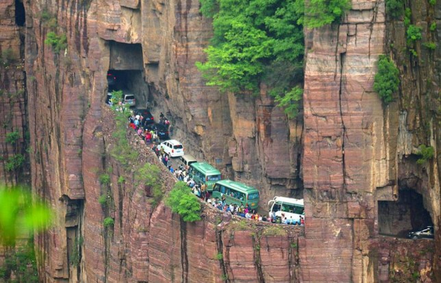 Mandatory Credit: Photo by Imaginechina/REX Shutterstock (4751625a)  Vehicles are stuck in a traffic jam on a cliff road  Traffic jam on cliff road, Huixian county, Henan province, China - 02 May 2015  Vehicles are seen stuck in a traffic jam on a cliff road in the Taihang Mountains in Huixian county, central China's Henan province. An influx of tourists to the area during the May Day holiday frequently brought traffic on the scenic road to a standstill, which is the only access route to and from Guoliang village.
