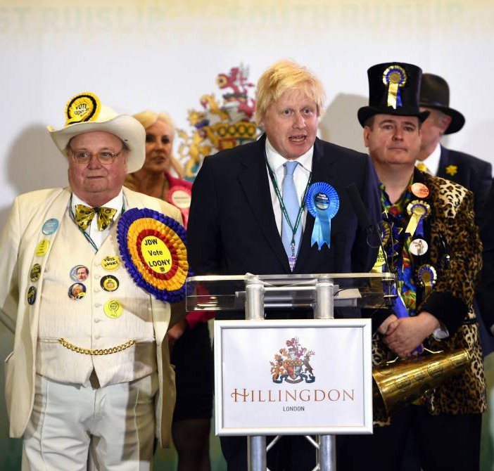 Boris Johnson (the one in the middle!) is BACK as an MP