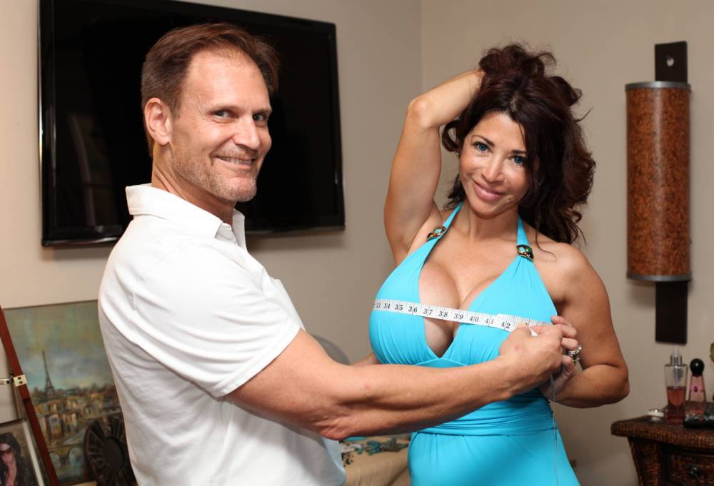 *** EXCLUSIVE - VIDEO AVAILABLE *** *** STRICT ONLINE EMBARGO UNTIL 00:01 ON WEDNESDAY 13/05 *** SUNRISE, FL - JANUARY 14: Ivan Le Casque measures Victoria's bust at their home on January 14, 2015 in Sunrise, Florida. IVAN LeCasque loves big boobs - so much so that he has written a book teaching men how to convince their partners to get breast augmentations. The 59-year-old lives in Miami with his partner and co-author Victoria, 47 - who has had her bosom enhanced from 500cc to 1650cc over the course of their relationship. The Convince Her Manual has sold 3,500 copies globally - and Ivan is proud that only one customer has taken advantage of the money-back guarantee. PHOTOGRAPH BY Ruaridh Connellan / Barcroft Media UK Office, London. T +44 845 370 2233 W www.barcroftmedia.com USA Office, New York City. T +1 212 796 2458 W www.barcroftusa.com Indian Office, Delhi. T +91 11 4053 2429 W www.barcroftindia.com