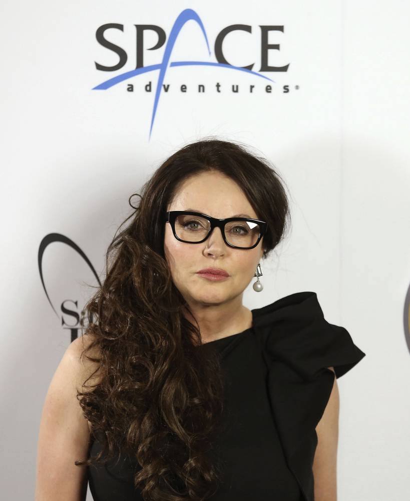 "File photo dated 10/03/2015 of British singer Sarah Brightman who has postponed her planned trip to the International Space Station. PRESS ASSOCIATION Photo. Issue date: Thursday May 14, 2015. She had been training in Star City near Moscow, and was due to blast off in a Russian Soyuz rocket on a tourist flight on September 1. But a statement on the soprano's website said she was setting the plans aside, and that for ""personal family reasons"" her intentions had changed. See PA story SHOWBIZ Brightman. Photo credit should read: Philip Toscano/PA Wire"