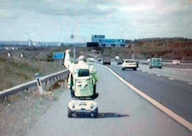 "This hilarious footage shows a pensioner giving police a thumbs up after he took a wrong turn on his mobility scooter and ended up on the MOTORWAY. See Ross Parry copy RPYSCOOTER : The elderly gentleman can be seen driving down the hard shoulder of the busy M1 motorway as he is followed by traffic police. The footage was later uploaded by the cops who put the video to music and tweeted: ""You can't beat some good tunes for a road trip!""The man was leaving a garden centre in Leeds, West Yorks., when he accidentally drove by mistake onto the M1 southbound at Junction 46."
