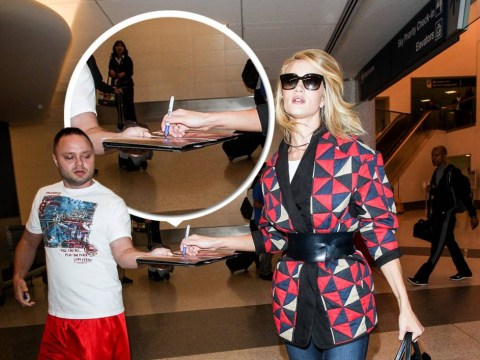 Rosie Huntington-Whiteley proves she is way too cool for your autographs
