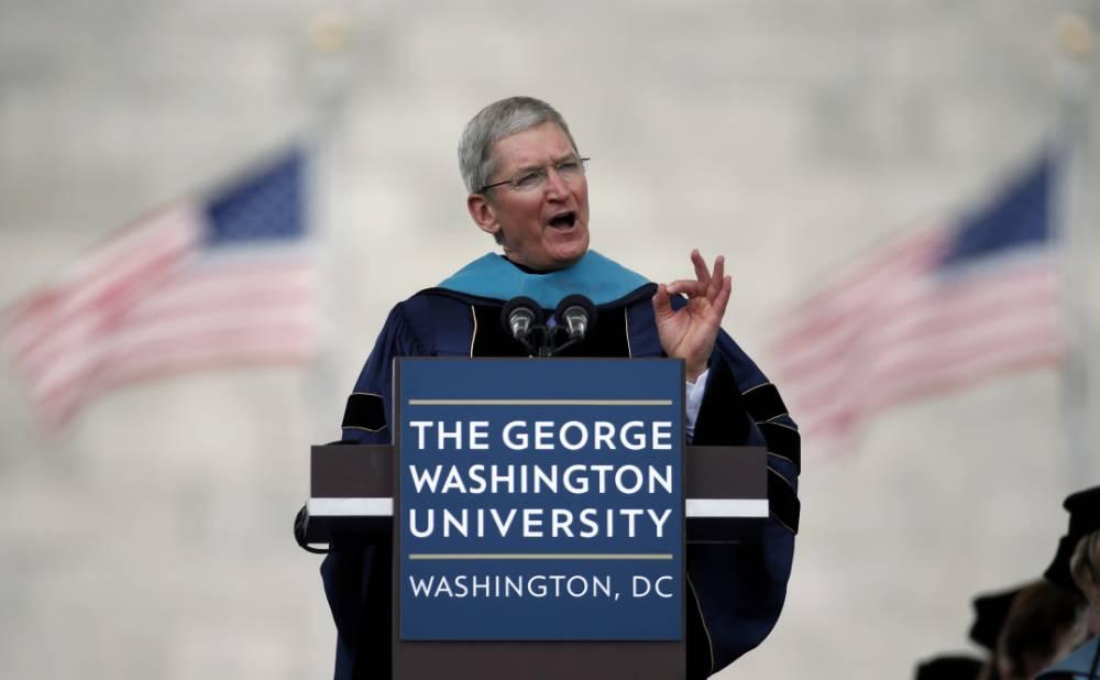 Apple CEO Tim Cook addresses graduates during George Washington University's commencement exercises on the National Mall, Sunday, May 17, 2015 in Washington. (AP Photo/Alex Brandon)