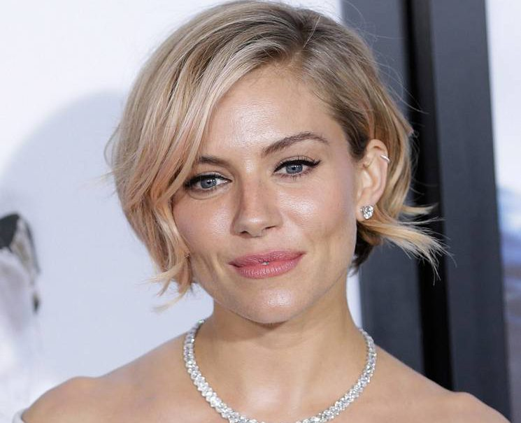 Sienna Miller feels grateful to have survived after strugging to cope with intense public scrutiny