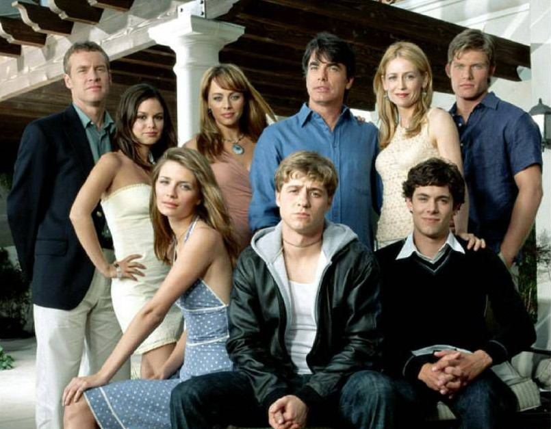 No Merchandising. Editorial Use Only. No Book Cover Usage  Mandatory Credit: Photo by Snap Stills/REX_Shutterstock (2204721be)  Tate Donovan as Jimmy Cooper, Rachel Bilson as Summer, Melinda Clarke as Julie Cooper, Peter Gallegher as Sandy Cohen, Kelly Rowan as Kirsten Cohen, and Chris Carmack as Luke.(front row) Mischa Barton as Marissa Cooper, Benjamin McKenzie as Ryan Atwood, and Adam Brody as Seth Cohen  The OC - 2004