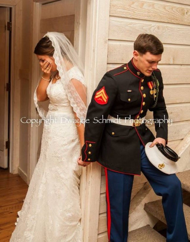***MUST LINK TO http://www.dwaynesimages.com/***  ASHEVILLE, NC (FOX Carolina) -  A wedding picture from Western North Carolina went viral Memorial Day weekend.  The picture is of U.S. Marine Corps Cpl. Caleb Earwood and his new wife, Maggie, before their wedding ceremony Saturday.  Caleb wanted to say a prayer with Maggie before they walked down the aisle. They closed their eyes and family members brought them together, making sure they never saw one another before the ceremony.   The bride said she was shocked the picture had gone viral so quickly.   Dwayne Schmidt Photography snapped their perfect wedding picture.    Copyright 2015 FOX Carolina (Meredith Corporation). All rights reserved.