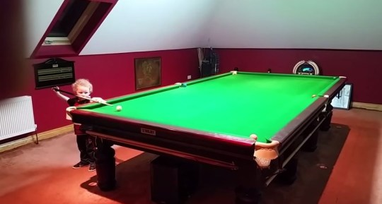 Adam Wynne plays snooker