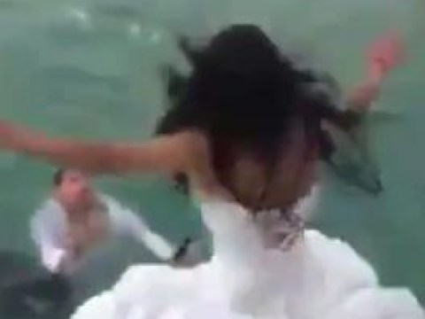 Bride nearly drowns after jumping into the sea in wedding 'trash the dress' stunt