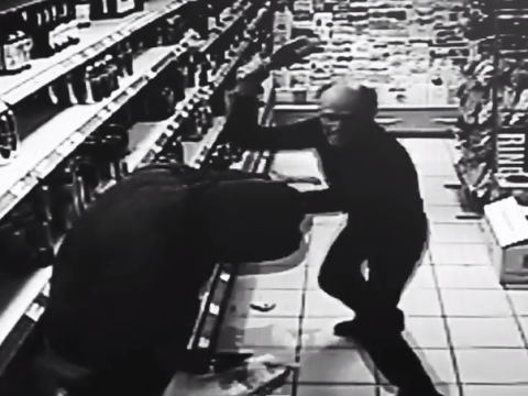 A shopkeeper fought off a would-be thief with a bottle of champagne