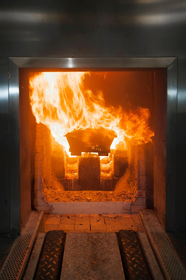 A coffin is cremated in the incinerator in a crematorium, Essen, North Rhine-Westphalia, Germany