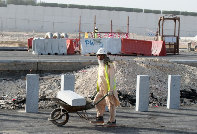 A construction worker in Qatar. Builders work on a construction site in Doha, Qatar, 10 March 2015. Qatar is to host the 2022 soccer world. Qatar drew international criticism concerning the vote to host the world cup and regarding the working conditions of foreign construction workers and buiders.  Photo by: Bernd von Jutrczenka/picture-alliance/dpa/AP Images