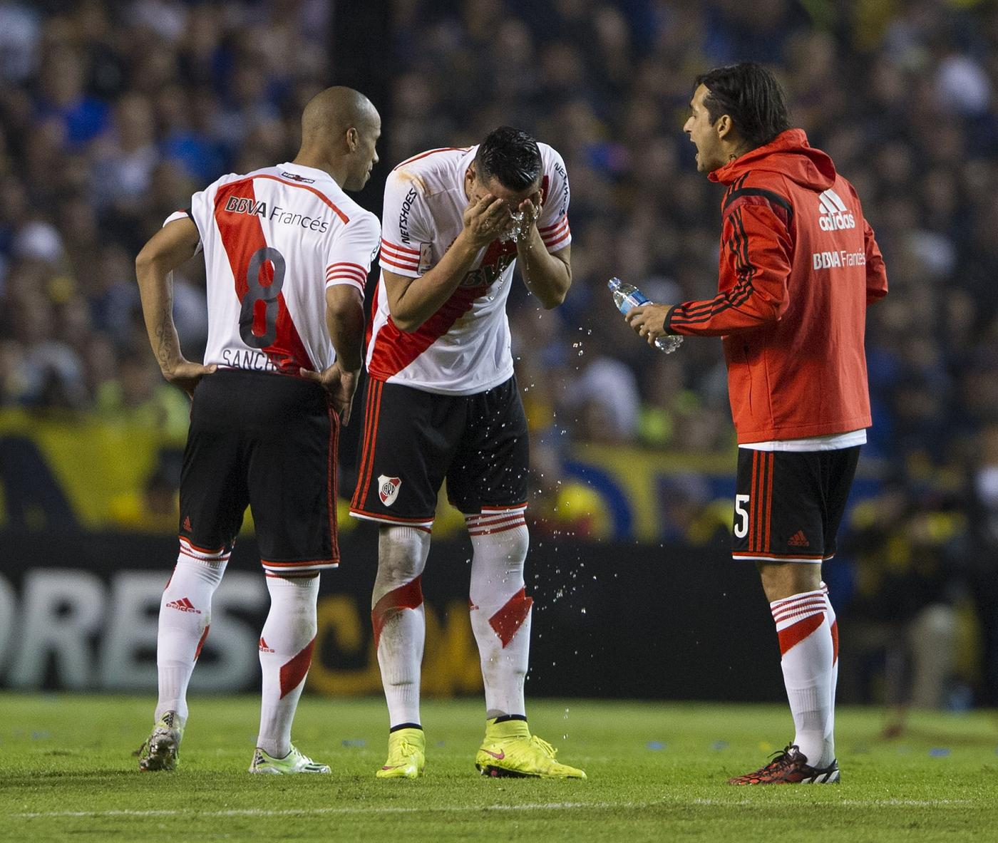 Boca Juniors v River Plate suspended 'after fan attacks players with pepper spray'