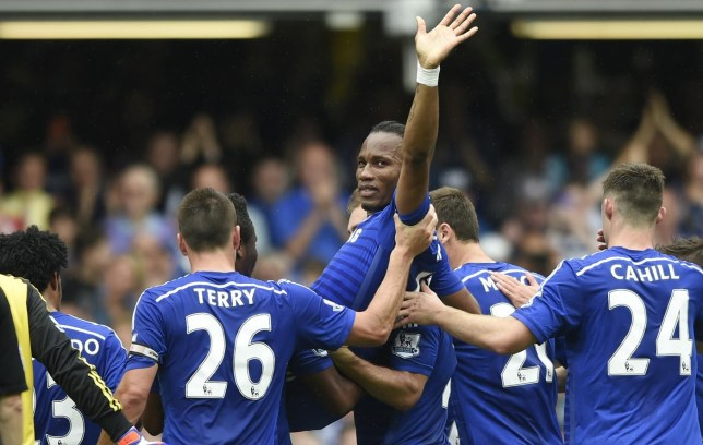 Football: Chelsea's Didier Drogba is carried off by team mates as he is substituted Tony O'Brien/Reuters