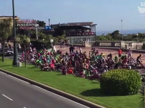 Fan tries to join Giro d'Italia stage two on his own bike, causes a giant crash