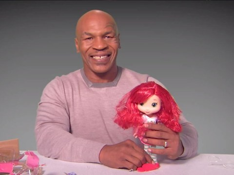 Mike Tyson playing with a Strawberry Shortcake doll makes for uncomfortable viewing